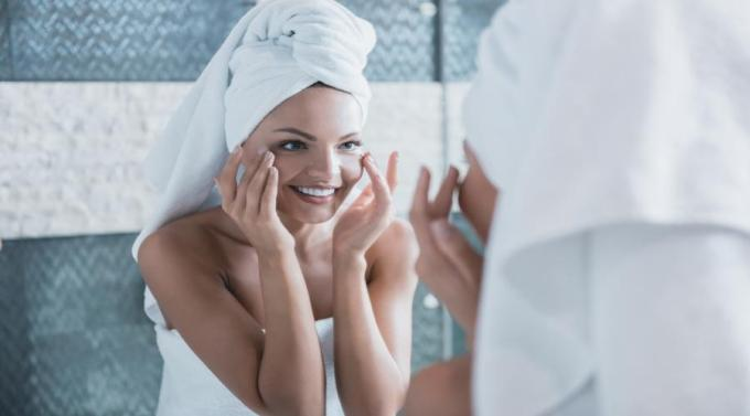 women applying moisturizer